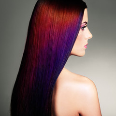 Beauty Fashion Model Girl with Colorful Dyed Hair. Girl with perfect Makeup and Hairstyle. Model with perfect Healthy Dyed Hair. Dark Hairstyles
