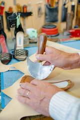 cobbler fixing soles