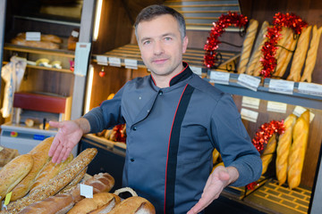 Baker presenting his range of breads