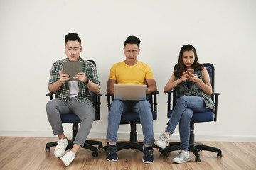 Young people with devices