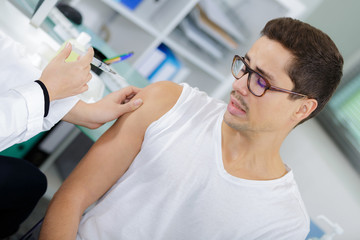 scared young man before injection