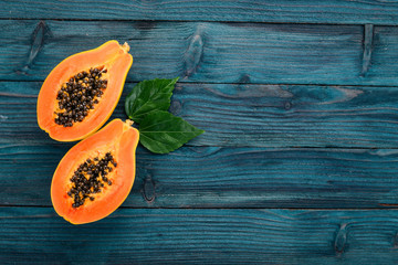 Image result for papaya on blue wooden table