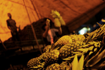 Pineapples are displayed for sale early in the morning at a wholesale vegetable market in Sao Paulo