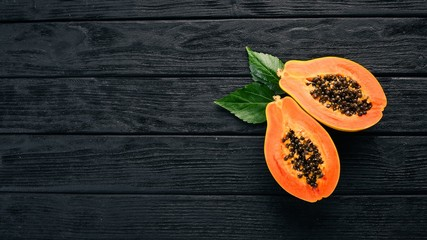 Papaya. Tropical Fruits. On a wooden background. Top view. Copy space. Wall mural