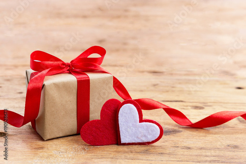 Valentine Gift Box With Red Hearts On Rustic Wooden Table With Copy