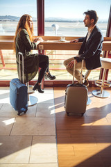 Man and woman drinking coffee in airport