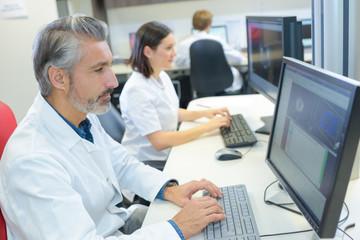 Male laboratory worker using computer