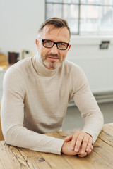 Confident stylish middle-aged man wearing glasses