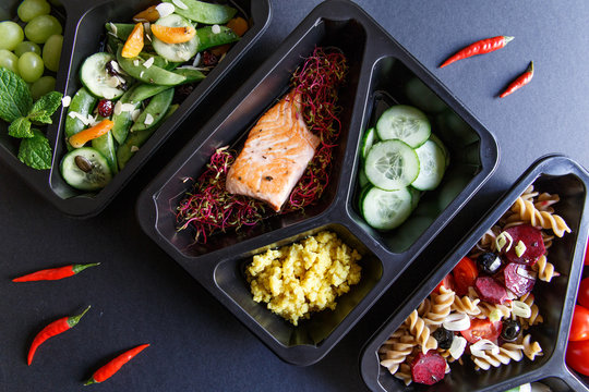 Healthy food and diet concept. Dietary catering. Restaurant dish delivery. Fitness meal. Take away. Fit and eat. Weight loss nutrition in foil boxes.