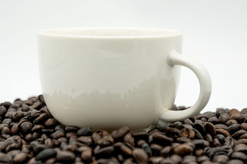 white coffee cup and coffee beans  isolated on white background .