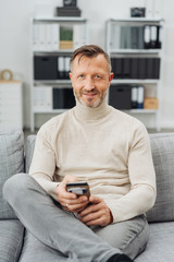 Confident relaxed trendy mature man