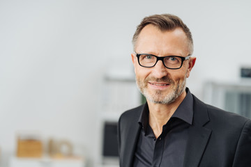 Middle-aged businessman wearing glasses Wall mural