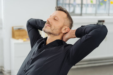 Businessman relaxing with his eyes closed
