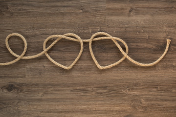 Two heart ropes connected to a knot