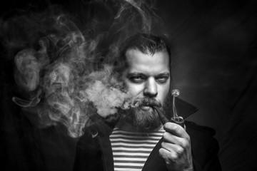 Artistic Sailor Man With Beard Smoking Pipe. Creativу Professional Portrait