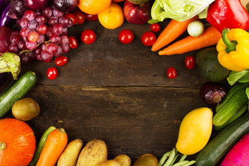 Fruits and vegetable lay on plank wood desk top view for background healthy eating