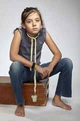 Seated girl looking at camera