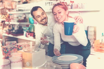Couple choosing new crockery in dinnerware store