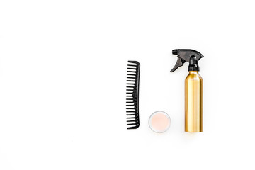 Professional hairdressing tools in beauty saloon. Combs, spray on white background top view copy space