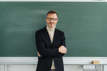 Confident middle-aged male teacher or professor