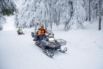 Mans on snowmobile