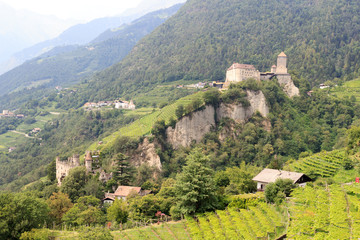 Tyrol Castle, castle Brunnenburg and mountain panorama in Tirol, South Tyrol