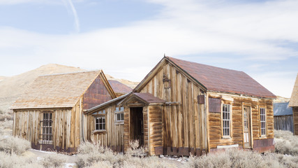vintage houses in the grassy plain of bodie ghost town