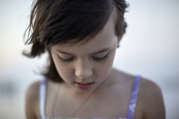 Close-up of girl standing at beach