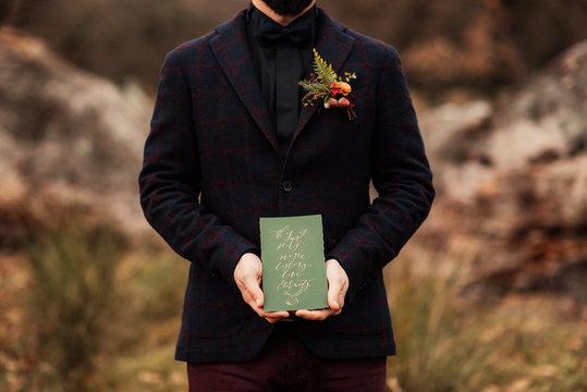 Man holding a handwritten letter