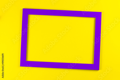 Purple Color Frame On Bright Yellow Background.