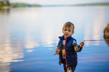 portrait of a boy on a background of water