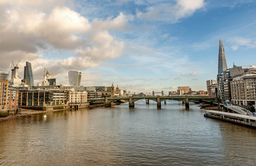 A view across the River Thames of financial skyscrapers of London,UK