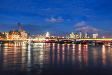 A view at dusk across the River Thames of financial skyscrapers of London,UK