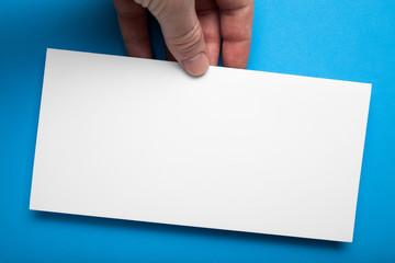 White empty DL Flyer Mock-Up on a blue background.