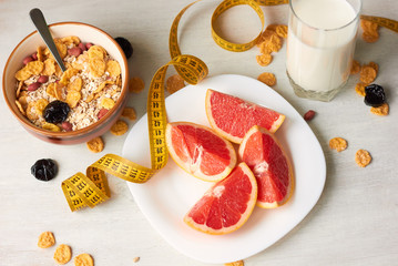 Useful breakfast from cereals of milk and grapefruit. The concept of a healthy diet.