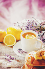 Tea with lemon in a cozy atmosphere. Selective focus.