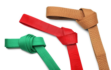 Red karate belt on white background