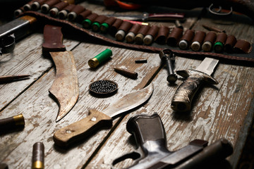 Hunting equipment on wooden background
