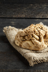celery root and burlap on dark wooden background