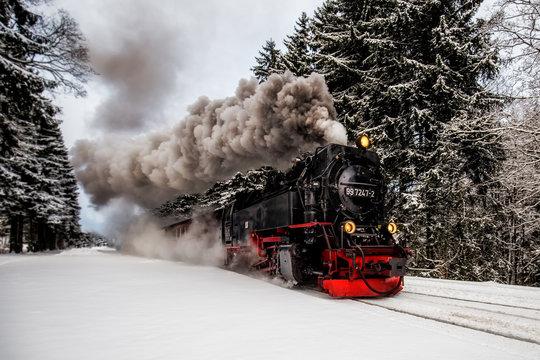 Steam train on the way to Brocken through winter landscape