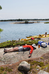 A group of active seniors on a guided sea kayak trip on the Great Lakes in Ontario, Canada.