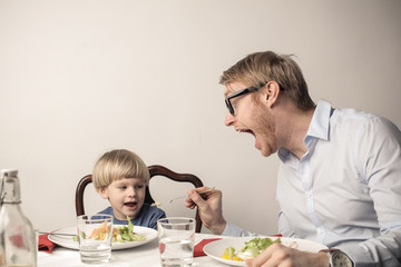 Eating with his son
