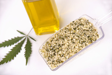 Scooper with a bunch of hulled edible hemp seeds