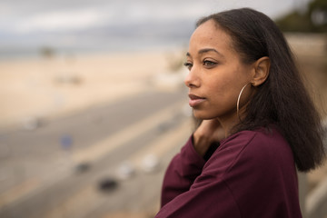 Young black woman looking far away thinking