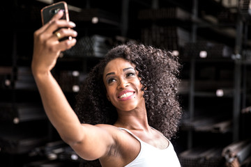 Black Woman Taking Pictures of Herself with Mobile