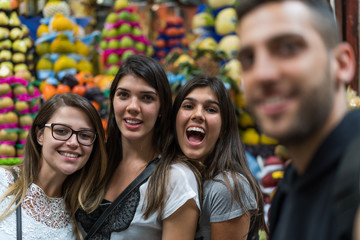 Friends taking a selfie with mobile in Food Market - Camera POV