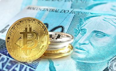 Bitcoin coins on Brazilian Real banknote, Cryptocurrency concept photo