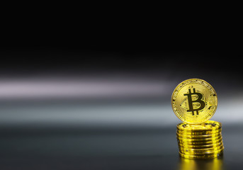Gold Bitcoin on black background. Concept electronic money in future.