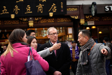 British Prime Minister Theresa May's husband Philip visits the Yu Yuan Garden in Shanghai