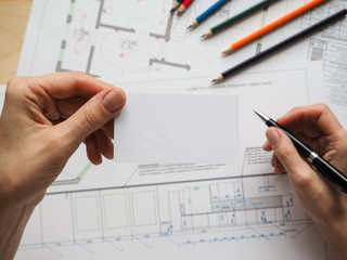 Business card on the background of an architectural project. The concept for the business project.
